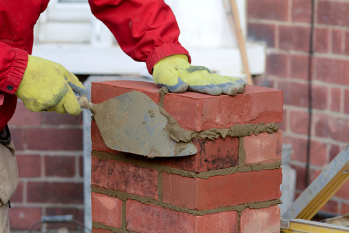 Builders forced to hire bricklayers from Portugal on £1,000 a week
